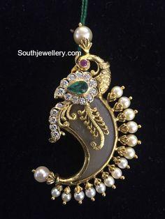 Peacock Puligoru Pendant - Jewellery Designs