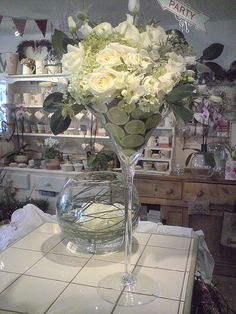 LOVE the giant martini glass with flower arrangement