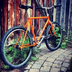 """@dcolpitts's photo: """"Yellow-now-Orange bike waiting to be let out the back gate from where great adventures begin. Rebuilt late 80's Specialized #Rockhopper now single speed intergalactic time machine."""""""