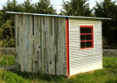 Reclaimed wood garden shed made in Portland. Love the beat up wood & bright red.