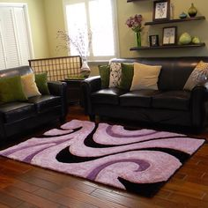 Enhance your home decor with this stunning area rug. With its abstract pattern, this area rug features rich shades of purple to complete the look.