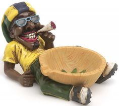 Features of Marijuana Ashtray Jamaican Man Holding the Ashtray. This Ashtray is made from a Special Material called Polyresin. Perfect Ashtray for Bathtub and Bedrooms. This is a greatMarijuana Ashtray ! Jamaican Men, Man Cave Gifts, Biscuit, Travel Icon, Smoking Accessories, Bar Accessories, Sculpture, Novelty Gifts, Clay Crafts