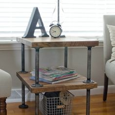 DIY industrial side table made out of plumbing supplies and butcher block countertop.