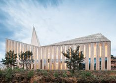 Oslo studio Reiulf Ramstad Arkitekter reinterpreted the traditional Norwegian stave church to create a modern chapel featuring folded timber surfaces and a pyramid-shaped spire.