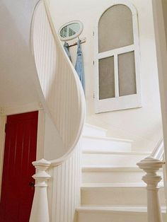 Staircase Makeover: The home's original dark and boxy staircase was given an open, curvy makeover. Now it combines curvaceous modern lines with old-fashioned beaded-board delights; an arched screen door serves as wall art. White Staircase, Curved Staircase, Staircase Design, Winding Staircase, Spiral Staircases, Stair Railing, Victorian Farmhouse, Country Farmhouse Decor, Modern Farmhouse
