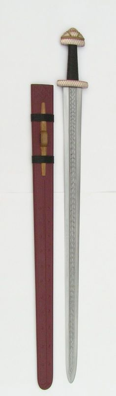 Viking sword pattern welded blade, silver and cooper inlay hilt with scabbard. Torblaa Ulvik, Norway 7thC.