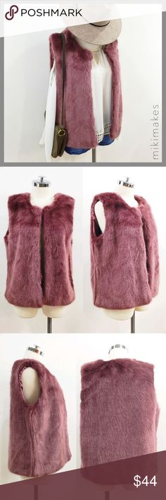 F21 • rouge berry faux fur vest Beautiful and unusual berry color faux fur vest from Forever 21.  Very soft and even color throughout.  Has crew neck and front closure with hook and eye.  Lining is also beautiful in berry satin.  Falls at the hip. Forever 21 Jackets & Coats Vests