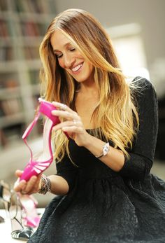 Sarah Jessica Parker and a pair of hot pink heels from her exclusive line for Zappos Couture