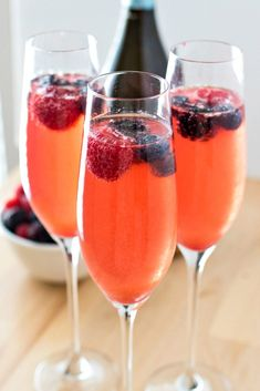 A refreshing and simple mimosa made with mixed berry simple syrup and prosecco or champagne. Garnish with a few berries and you've got yourself the perfect drink for summer!