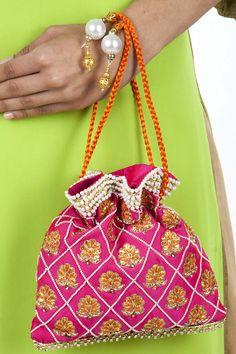 Fuschia silk potli available by NAMRATA KUMAR. Shop now at perniaspopupshop.com