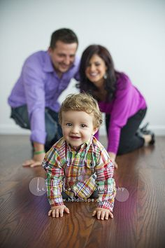 cute family portrait with toddler, having parents out of focus in background