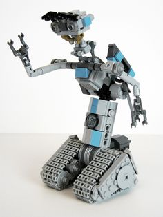 Johnny Five Number a. Johnny Five, is the hero of the Short Circuit movies. Number 5 was one of five prototype robots, but after [. Lego Robot, Lego Mecha, Robots, Johnny Five, Mr Printables, 2017 Planner, Ice Cream Theme, Lightning Strikes, Number 5