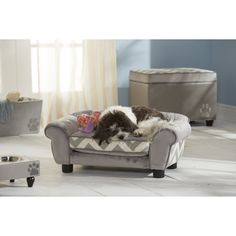 Enchanted Home Pet furniture eases your pet into a luxurious cushion that engulfs them in complete comfort and warmth. A trendy chevron pattern and versatile grey color completes this comfortable pet bed.