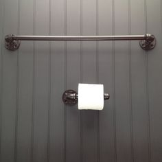 Finished pipe bathroom fixture set with two towel racks and toilet paper roll holder