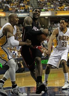 Miami forward LeBron James muscles for inside positioning in the Heat's victory at Indiana Sunday afternoon.