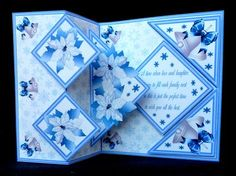 These fold back kits with a pop-up inside are very easy to make. The kits includes easy to follow photographic instructions. This one is decorated with blue poinsettias and silver bells and the verse reads;- A time when love and laughter seems to fill each family nest so this is the perfect time to wish you all the best.