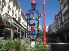 Starting back the way she had come, Mairead was quite clear of the route and within several minutes she was admiring one of Wellington's more quirky icons.  The fountain consisted of several scooped red, yellow and blue buckets set into a metal frame at different heights.   Excerpt from The Finest Line