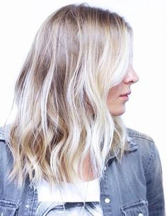 babylights with dark roots give off a beachy vibe