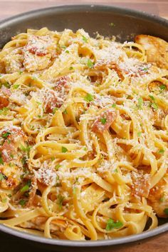 Chicken Carbonara     12 oz. fettuccine     4 slices bacon     3 cloves garlic, minced     1/2 lb. boneless skinless chicken breasts, cut into strips     kosher salt     Freshly ground black pepper     4 large eggs, beaten     3/4 c. freshly grated Parmesan, plus more for garnish     1/3 c. freshly chopped parsley, plus more for garnish