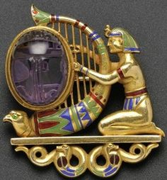 Brooch; Starr (Theodore B), Egyptian Revival, Enamel Figure Playing Harp, Amethyst Scarab, Snake Support