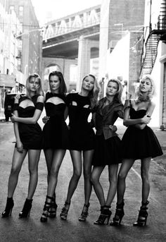 This would be a cool picture to take with all my girl friends senior year. Everyone in black dresses and black heels. <3