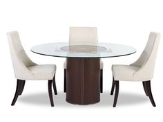 Dania - Sleek with modern lines, the Dorine round dining table features a synthetic leather base with contrast stitching and glass top.  Available in a black  or brown synthetic leather.