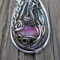 Sterling Silver wire wrapped Vesuvianite by MineralSynergy on Etsy, $350.00