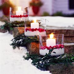 Christmas Cranberry Luminarias-greenery base, kosher salt, cranberries and pillars. In pairs on both sides of steps. Remove greenery for Valentines.