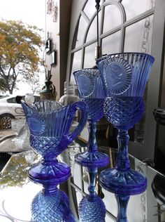 Fostoria for Avon blue glass pitcher & goblets / candle holders