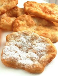 Pinner says: County Fair Fried Dough - Mmmm.I used to make fried dough with store bought bread dough all the time as a kid. Growing up hasn't stopped me from eating fried dough, but now I can make the dough from scratch! Köstliche Desserts, Delicious Desserts, Dessert Recipes, Recipes Dinner, Fried Dough Recipes, Gluten Free Fried Dough Recipe, Fried Dough Recipe Without Yeast, Biscuit Dough Recipes, Pain Frit