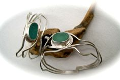 Hand crafted sterling silver cuff bracelets with beach glass.
