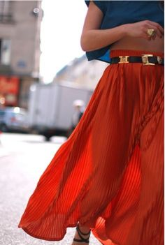 love maxi skirts for the summer, especially in this bright orange with a statement belt