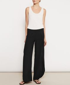 <p>The classic Toulon Trousers are cut from lustrous silk and have split cuffs that flutter beautifully as you walk. The plain waist band and zip at back creates a comfortable fit for the wearer.</p>