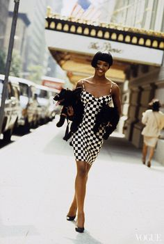 No other accessories needed. Naomi Campbell photographed by Arthur Elgort, November 1989