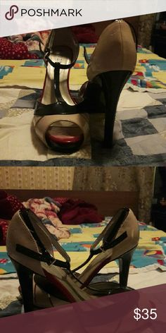 GUESS High heel Beige, red, and black high heel.  This shoe has not been worn only tried on.  Size 10M.  The shoe is not brand new but has been with me for four years. Guess Shoes Heels
