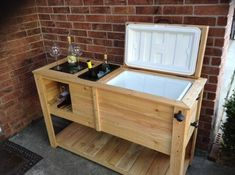 """""""Custom made wooden patio cooler with built in wine rack and wine ice bucket. Contains a new 52 qt Igloo cooler. Made from cedar wood. Granite chopping block on one side as well as ice bucket for the Wood Cooler, Pallet Cooler, Patio Cooler, Outdoor Cooler, Cooler Stand, Ice Cooler, Cooler Box, Wine Rack Design, Built In Wine Rack"""