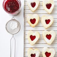 Ingredients: icing sugar plain flour, cornflour ground almonds pack cold butter, cut into cubes 1 tsp almond extract 8 tbsp morello cherry/ raspberry jam, sieved Gluten Free Linzer Cookie Recipe, Best Gluten Free Cookies, Gluten Free Baking, Vegan Christmas Cookies, Heart Shaped Cookies, Heart Cookies, Valentines Day Cookies, Allergy Free Recipes, Chocolate Cookies