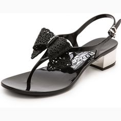 Salvatore Ferragamo Perala Sandals Authentic  Salvatore Ferragamo Perala Black Sandals Black with silver hardware  Black Jellies w/Silver heel (1inch) Ferragamo silver logo on bow on inner heel Purchased from Neimen Marcus for $314.00 (with tax) Comfy, can be worn with any outfit   Only worn a few times, lost original box but I have an extra Ferragamo shoe box  Animal/smoke free home (small mark on heel, not noticeable when wearing) Salvatore Ferragamo Shoes Sandals