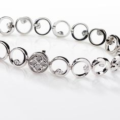 Timeless and classic, this Colin Cowie bracelet features brilliant round diamonds in an elegant design of 14k white gold.