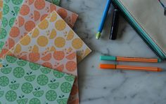 THE DETAILS: - Set of 6 5.5 x 4.25 (A2) Fold Over Notecards - Color options: Orange, Yellow, Green, or Multi - Hand-cut, folded, and printed on a
