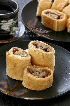 Easy Banana Strudel with cinnamon flavored bananas, breadcrumbs, and walnuts wrapped in fillo dough. Delicious on its own or with a scoop of ice cream. | Roti n Rice