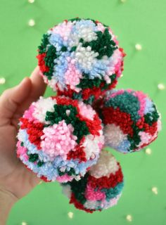 If you& looking to add some fun and color to your Christmas tree look no further. These DIY multicolored pom pom ornaments are adorable and inexpensive! Christmas Pom Pom Crafts, Diy Christmas Ornaments, Christmas Fun, Pom Pom Garland, Pom Poms, Diy Finger Knitting, Craft Stick Crafts, Diy Crafts, Pom Pom Flowers