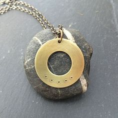 This necklace is inspired by my Five Deep Breaths practice, which invites you to pause and take five deep breaths with intention. As you breathe, relax your shoulders, notice how your breath moves in your body, try to let go of anything pulling on you, feel the space you create inside you, and let your mind rest in this space.