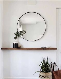 round black mirror in the entrance area over a floating wooden shelf small entrance area . Round black mirror in the entrance above a floating wooden shelf. Small entrance decoration ideas , round black mirror in entryway above floating timb. Shelf Decor Bedroom, Decor, Home Decor Inspiration, Timber Shelves, Home N Decor, Small Entryway, Room Decor, Apartment Decor, Hallway Decorating