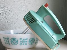 Vintage mixer--I have this one, only it's off-white - blechh. Still, my mom bought it for me at a garage sale in 1984, and it still works great. Now, I must find one this color, or find some way to paint the one I have.