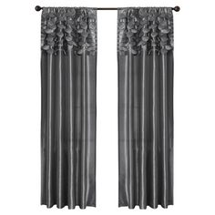 Gray curtain with textural circle accents.  Product: Set of 2 curtainsConstruction Material: Polyester