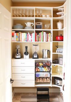 Walk-in pantry with area for large appliances! just needs a lazy suzan in the corner and a darker wood than white! love this   best stuff