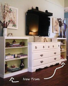 Take an old dresser, 2 bookcases, paint, and trim. Make your own entertainment center on the cheap!