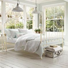 bedroom on a sun porch with romantic + industrial elements