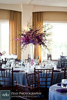 large purple orchids centerpiece. Purple and grey wedding colors. Pretty!!  This way guest can still talk across the table and actually see each other